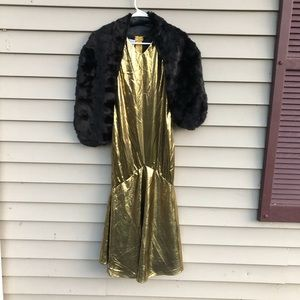 Gold lame flapper dress with black fur shawl witchcraft
